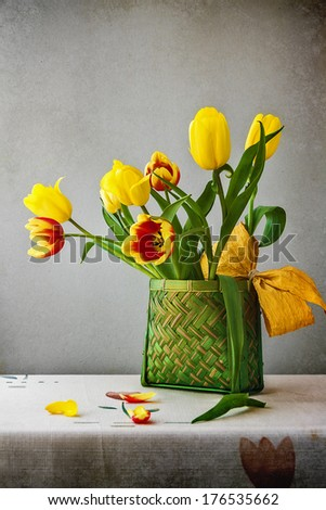 Still life with a bouquet of tulips in a classic style - stock photo