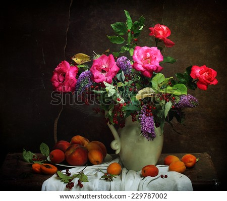 Still-life with a bright bouquet and fresh peaches, juicy ripe peaches and a magnificent bouquet from gentle roses and bird cherry branches - stock photo