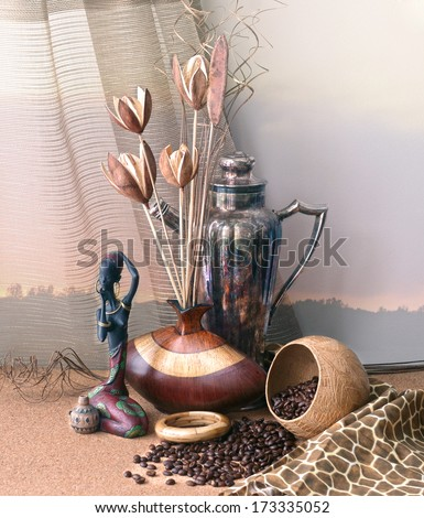 still life with a carving statue of an african woman, natural dried flowers, vase and coffee beans - stock photo