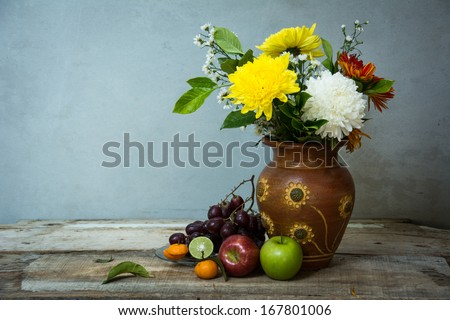 Still life with a flowers and passion fruit.  - stock photo