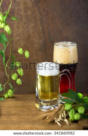 Still Life with a keg of beer and draft beer by the glass - stock photo