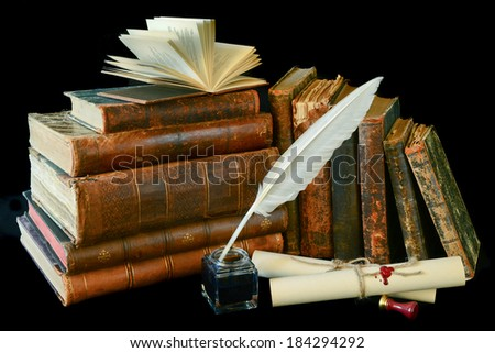 Still life with a letter, a pen and old books on a black background - stock photo