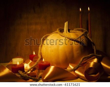 Still life with a pumpkin and candles. Halloween.