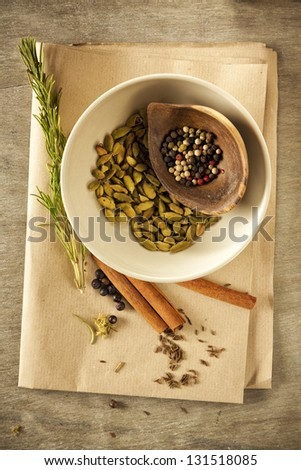Still life with a variety of dried spices and herbs, from above
