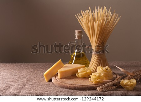 Still life with a variety of macaroni and cheese - stock photo