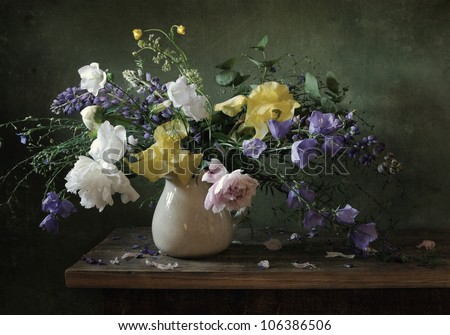 Still life with a voluptuous bunch of flowers - stock photo