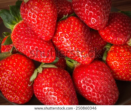 Still life with a whole, ripe, juicy strawberries - stock photo