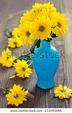 Still life with a yellow flowers chrysanthemum. - stock photo