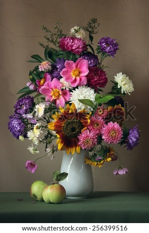 still life with an autumn bouquet and apples - stock photo