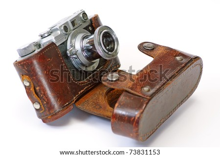 Still life with antique camera - stock photo
