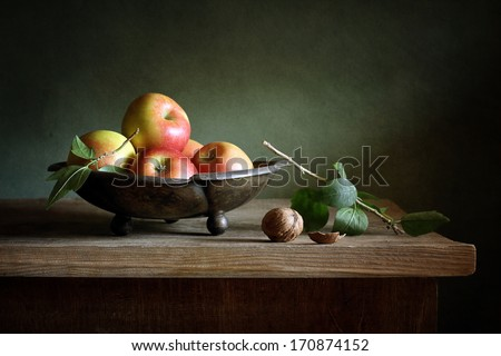 Still life with apples and a walnut - stock photo
