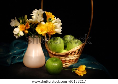 Still life with apples and flowers - stock photo