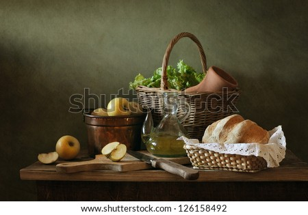 Still life with apples and fresh bread - stock photo