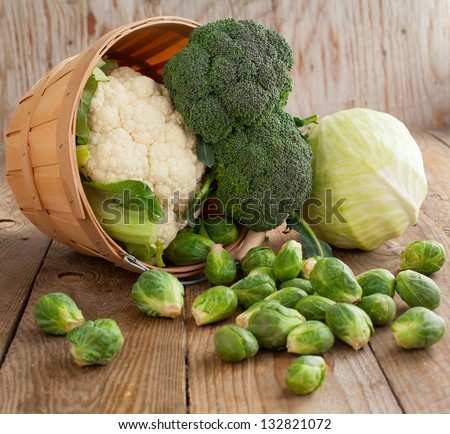 Still life with assortment cabbages on wooden background - stock photo