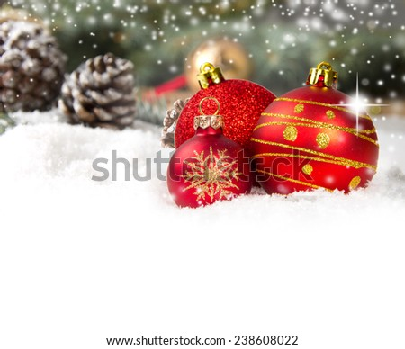 Still life with balls and cones covered with snow with white space for the text - stock photo