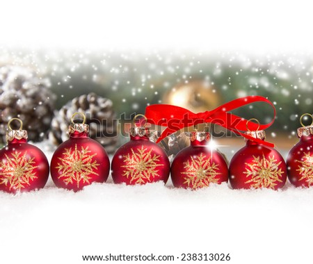 Still life with balls in a row and cones covered with snow with white space for the text - stock photo