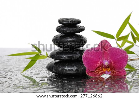 Still life with bamboo leaves and wet stones with orchid  - stock photo