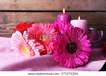 Still life with beautiful bright gerbera flowers on wooden background - stock photo