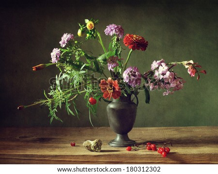 Still life with beautiful flowers and berries - stock photo