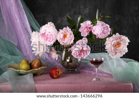 Still life with beautiful pink peonies and fruit - stock photo