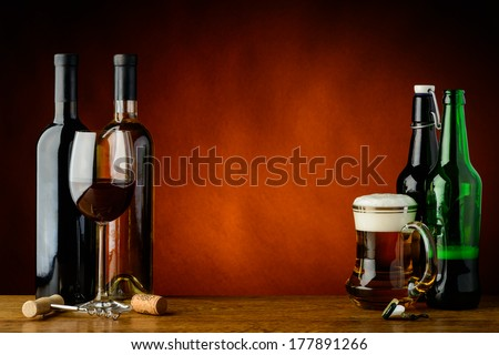 still life with beer and wine and text copy space - stock photo