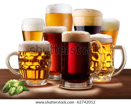 Still-life with beer glasses. On a white background. - stock photo