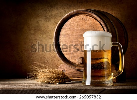 Still life with beer on a textured background - stock photo