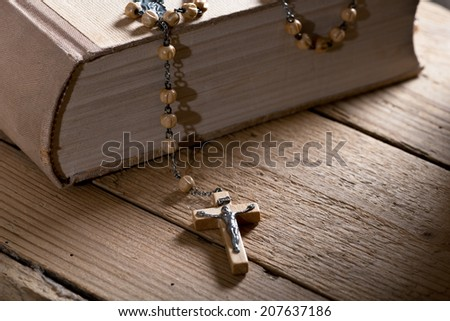still life with bible and prayer beads - stock photo