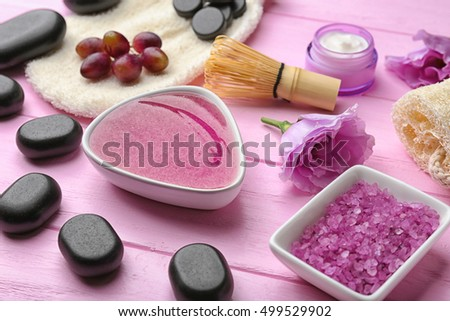 Still life with body care products on wooden background