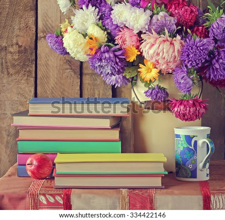 Still life with books and a bouquet of asters. Back to school. - stock photo
