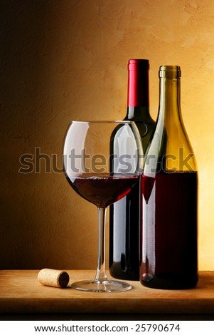 Still-life with bottle of red wine and glass - stock photo