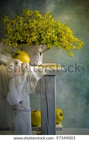 still life with bouquet and yellow apples - stock photo