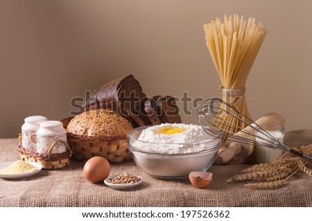 still life with bread, pasta and wheat - stock photo