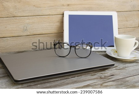 Still Life with business equipment on wood - stock photo