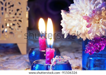 still life with candles and flower - stock photo