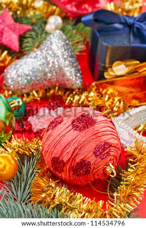Still life with Christmas decoration balls on red background - stock photo