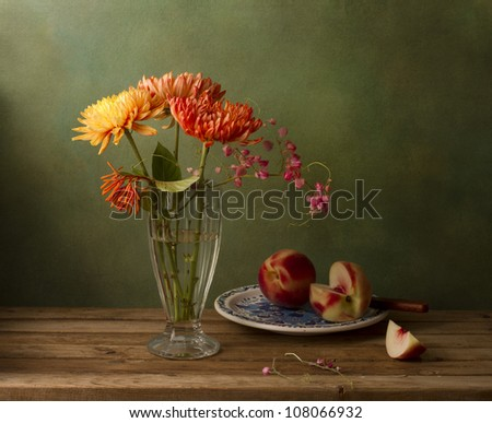 Still life with chrysanthemum flowers and peaches - stock photo