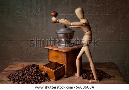 Still Life with Coffee grinder and jointed doll working the mill