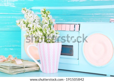 Still life with colorful retro radio, on blue wooden background - stock photo