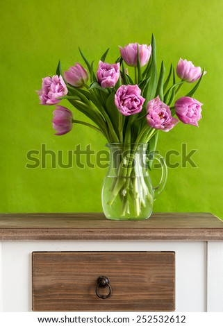 Still life with colorful tulips - stock photo