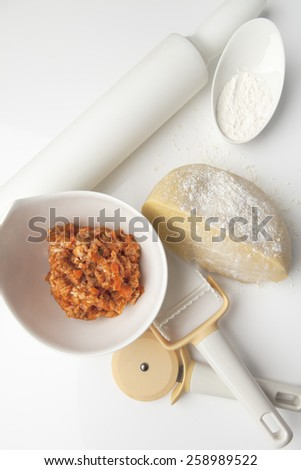 Still life with cooking ingredients for making ravioli Still life with cooking ingredients for making ravioli on white background - stock photo