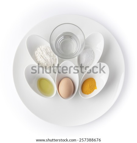 Still life with cooking ingredients in white utensils on white background - stock photo