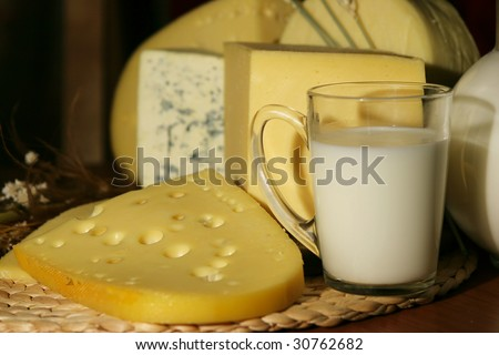 Still-life with dairy products - cheese and milk - stock photo