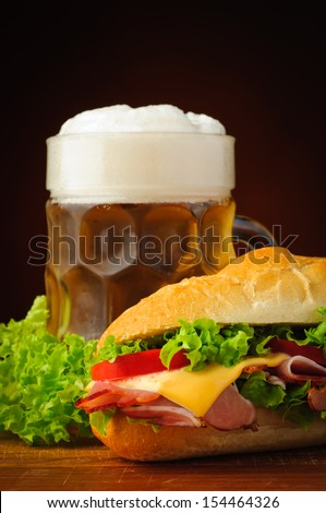 still life with deli sub baguette sandwich and beer - stock photo