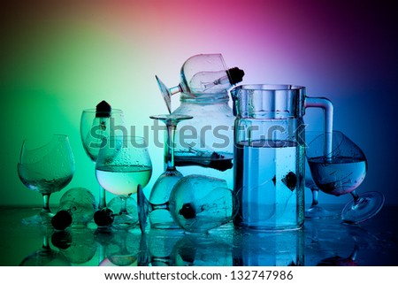 Still Life with differently shaped glass bottles and light bulbs