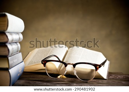 still life with eyeglasses and books on the table - stock photo