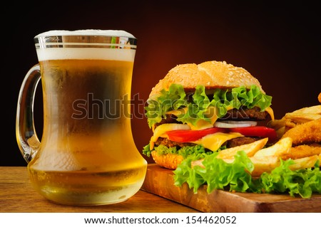 still life with fast food and fresh cold beer