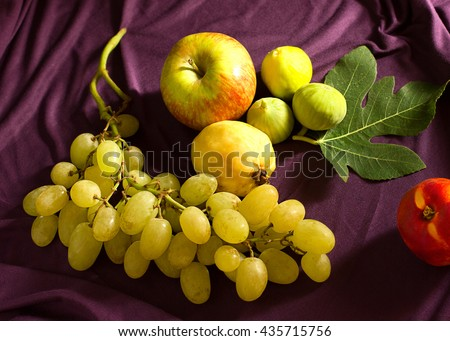 still life with figs, green grape, peach and apple. Healthy food - stock photo