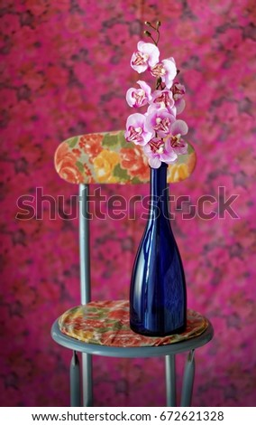 Still life with floral background with chair and a branch of fake orchids in a blue & Still Life Floral Background Chair Branch Stock Photo (Royalty Free ...