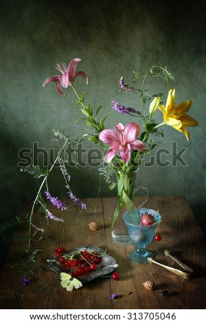 Still life with flowers, berries and insects (textured for artistic effect) - stock photo